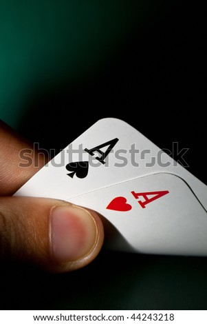 Fingers holding winning cards - stock photo