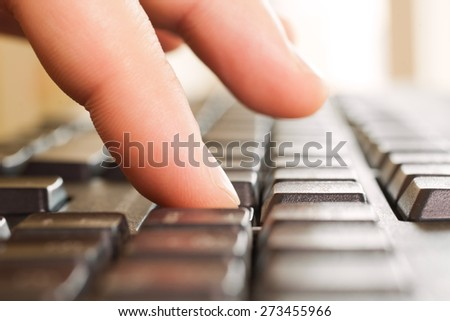 Fingers on a computer keyboard closeup - stock photo