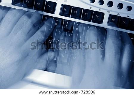 fingers on keyboard - stock photo