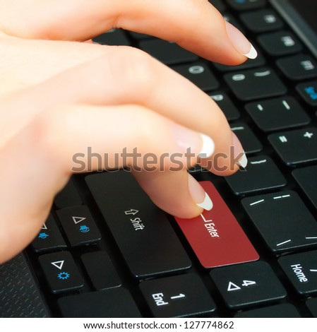 Fingers to keyboard buy now (enter) - stock photo