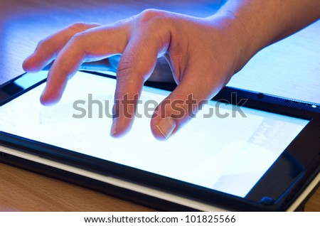 fingers touching screen on tablet-pc - stock photo