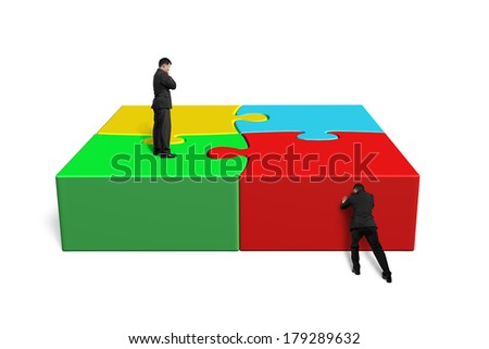 Finish assembling puzzles isolated in white background - stock photo