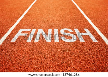 Finish line on athletics all weather running track - stock photo