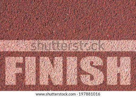 Finish line on red asphalt - stock photo
