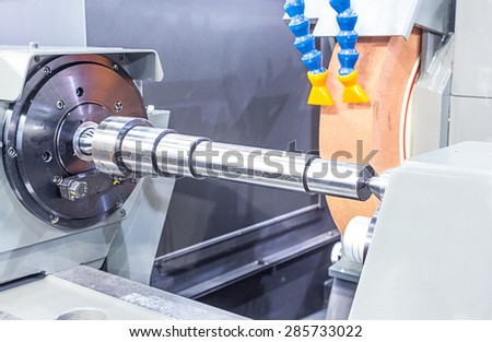 Finishing metal working on high precision grinding machine - stock photo