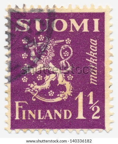 FINLAND - CIRCA 1930: A stamp printed in Finland shows lion coat of arms, circa 1930