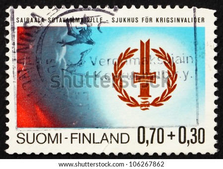 FINLAND - CIRCA 1976: A stamp printed in the Finland shows Disabled War Veterans� Emblem, circa 1976 - stock photo