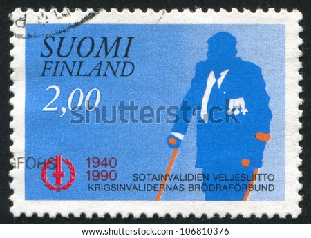 FINLAND - CIRCA 1990: stamp printed by Finland, shows Disabled Veteran, circa 1990 - stock photo