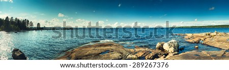 Finland lake panorama. Dramatic contrast colors. - stock photo