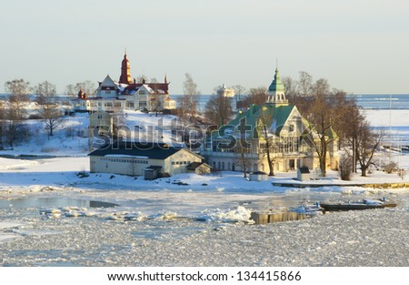 Finnish houses on the island in the Baltic sea during the period of the ice drift (near Helsinki, Finland) - stock photo