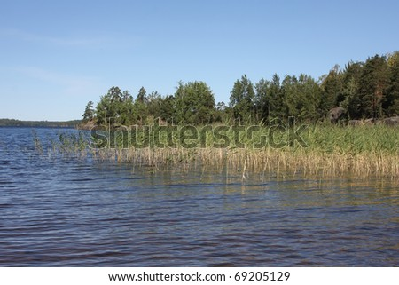 Finnish lake coast in summer - stock photo