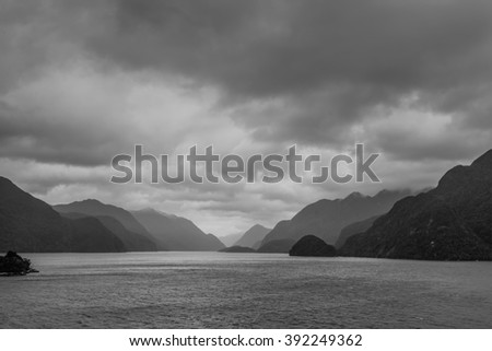 Fiordland National Park Scenic in rainy weather with dramatic sky - Park occupies the southwest corner of the South Island of New Zealand - black and white photography - stock photo