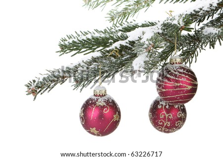 Fir branch with christmas toys and snow on a white background. - stock photo