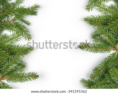 fir branches border on white background, good for christmas backdrop - stock photo