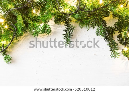 Fir tree and lights festive frame, Christmas holiday decoration