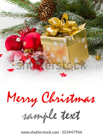 fir tree and red christmas decorations  and gift box on white snow - stock photo