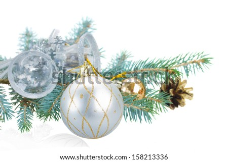 fir tree branch and silver  decorations isolated  on white background