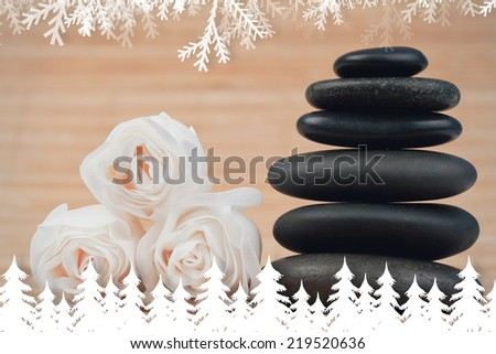 Fir tree forest and snowflakes against close up roses and a black pebbles stack - stock photo