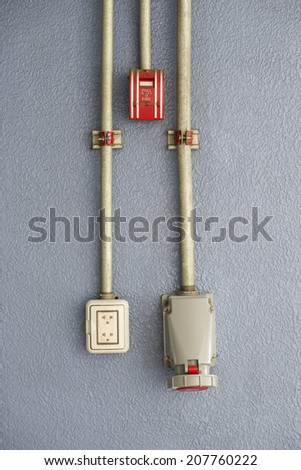 Fire alarm and electric plug - stock photo