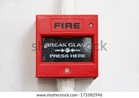 fire alarm box on cement wall for warning and security system - stock photo