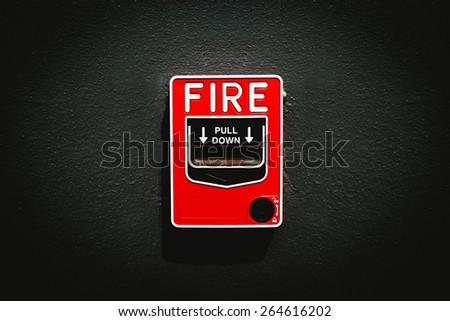 fire alarm on gray dark wall - stock photo