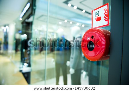 Fire alarm on the wall of shopping center. - stock photo