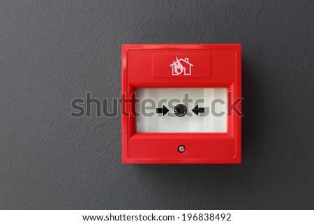 Fire alarm security button isolated on black - stock photo