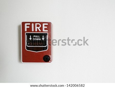 Fire alarm switch on wall - stock photo