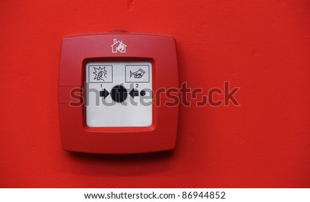 fire alarm system button on red wall - stock photo