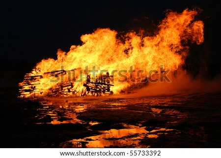 Fire and flames on a black background - taken at night - stock photo