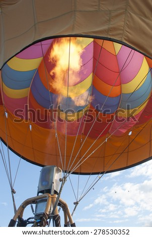 Fire and inside view of hot air balloon prior to launch - stock photo