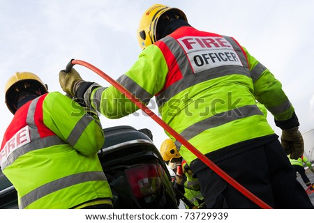 Fire and Rescue Emergency Units at car accident with Power Wedge - stock photo