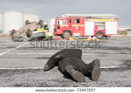 Fire and Rescue Emergency Units at car crash training - stock photo