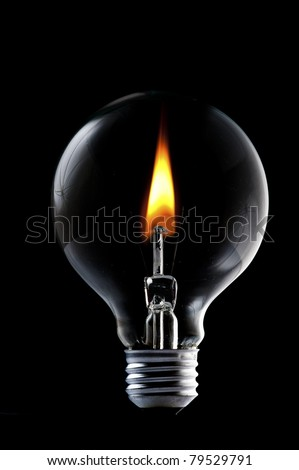 Fire and smoke in side the light bulb. Concept for energy consumption and environmental awareness - stock photo
