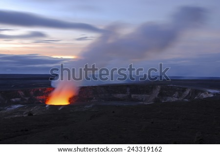 Fire and steam erupting from Kilauea Crater (Pu'u O'o crater), Hawaii Volcanoes National Park, Big Island of Hawaii - stock photo