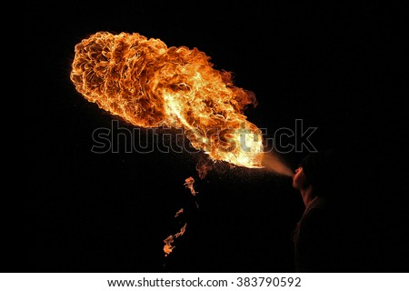 Fire artist performing extreme fire breathing