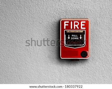 fire break glass on wall - stock photo