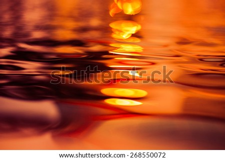 Fire burn water  sunset reflection on water (sweet tone) - stock photo