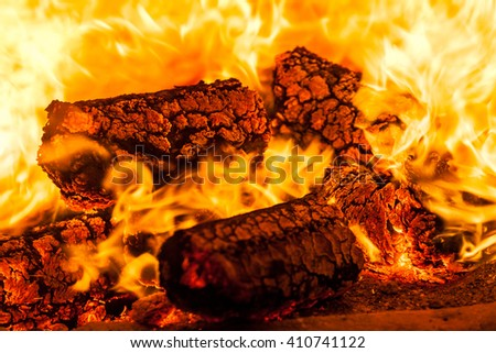 Fire. Burning firewood. Heat. Flame. Burning. The fire in the fireplace. Heat - stock photo