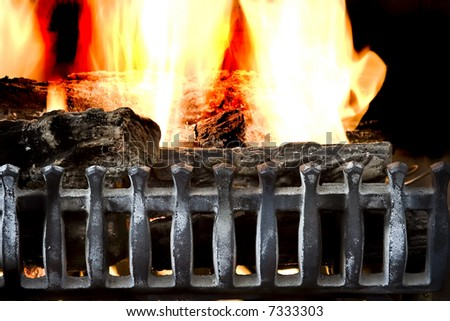 fire burning in a fireplace close up background photo - stock photo