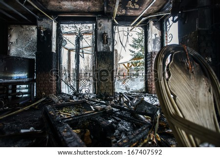 Fire damaged interior details in summer house after blaze - stock photo