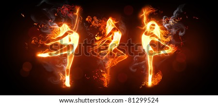 fire dancers on the black background - stock photo