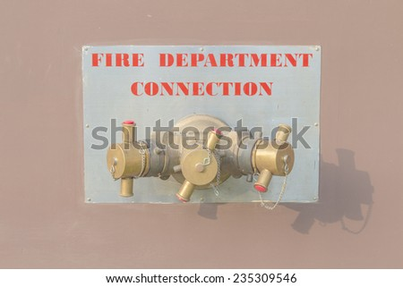 Fire Department Connection on wall - stock photo