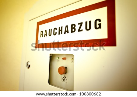 "Fire emergency box with german word ""Rauchabzug"" to release smoke - stock photo"