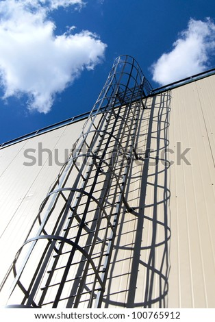 Fire escape on a wall - stock photo