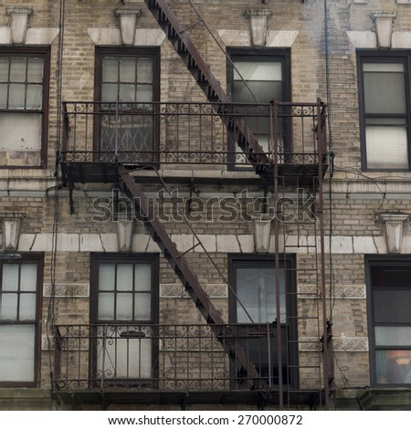 Fire Escape on exterior of a building, Midtown, New York City, New York State, USA - stock photo
