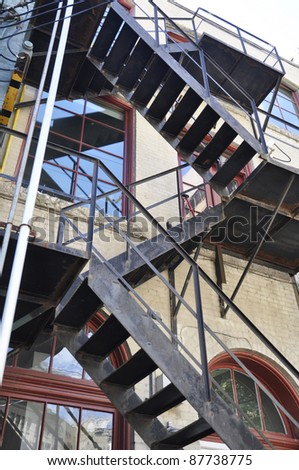 fire escape stairs on old apartment building - stock photo