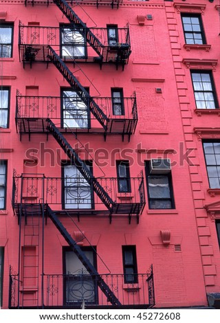 Fire escapes run diagonally down colorful apartment buildings in Greenwich Village, NYC - stock photo
