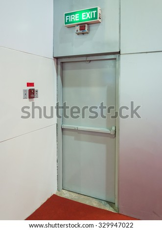 Fire exit door of the large exhibition hall. - stock photo