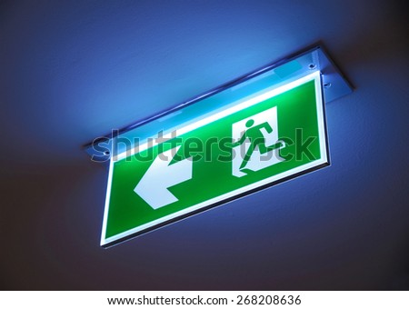 Fire exit ,green emergency exit sign. - stock photo